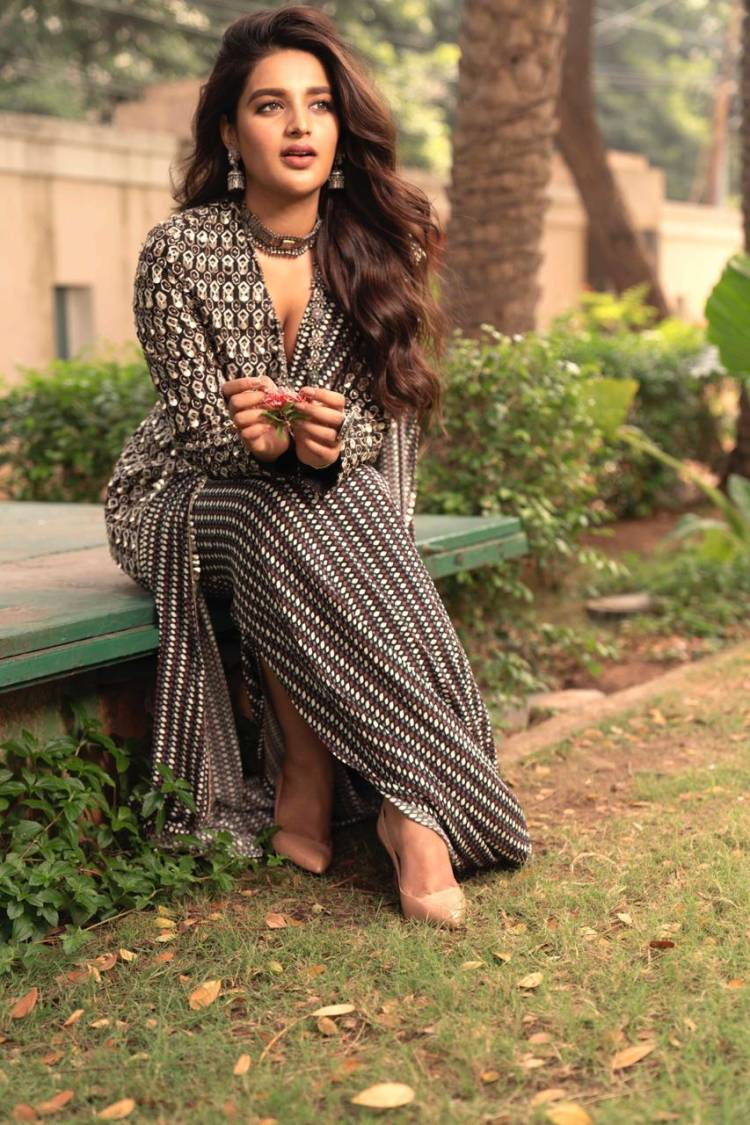 The bright & beautiful #NidhhiAgerwal is busy promoting her pongal releases #Bhoomi & #Eeswaran